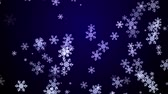 Snowflakes fall on a dark blue background