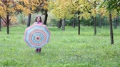 little : happy little girl with umbrella in autumn park