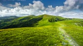 旅遊 : Summer landscape. Mountain path on the cloudy sky background. Panorama in Carpathian Mountains, Pip Ivan, Chorna Gora, Ukraine. Slow motion 4K footage