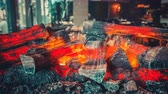 Close-up burning firewood in the interior of the contemporary restaurant. Modern loft style design. Wood burn and the air melt from the heat. Blue color filter toning. 4k Slow Motion Parallax Effect Vídeos