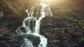 declive : Fast Wild Nature Highland Stream Flow Stony Ground. Mountain Waterfall Creek Motion Rocky Slope Overview. Brook Cascade Soft Sun Beam Eco Friendly Environment Concept Drone Flight Footage 4K (UHD) Stock Footage