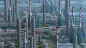 izometrik : Oil and gas refinery plant factory, orbit view, defocus shot, industry petroleum zone, pipe steel and oil storage tank. Aerial drone fly over plant shot. 3D generated image. Stok Video