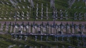 transformatör : Electric substation, power station, electric tower, power distribution. Early morning spring summer sun shadows. Aerial quadrocopter panorama flying. Stok Video