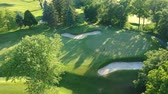 Golf course with two player in the evening. Eye bird view from the sky. Aerial footage of park forest and golf course. Stock Footage