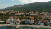 dalmácia : Scenic aerial bird view at morning coastal village near Split in Croatia, calm and quite tourist vocational hotel seafront under green mountains in Europe. Early morning. Vídeos