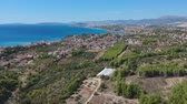 tarihi : Idyllic hill village town mountains of Split aerial view, region of Croatia near sea. Stok Video