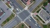 életmód : Aerial view of intersection or road junction with moving cars in American town. Stock mozgókép