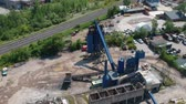 toplamak : Aerial view of heavy machinery for crushing and collecting stone, limestone, sand and gravel, materials for asphalt producers and paving road, construction. Road asphalt plants recycle and storage. Stok Video