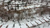 hava durumu : High level of snow storm, winter weather forecast alert day in the city. Top aerial view of people houses covered in snow, bird eye view suburb urban housing development. Quite neighbourhood.