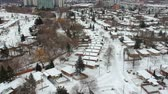 явление : Aerial view of the roads and people houses below at snow storm, winter weather alert day. City road aerial view taken from above scenery. Top bird view suburb urban housing development. America. Стоковые видеозаписи