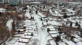 hava durumu : Aerial view of the roads and people houses below at snow storm, winter weather alert day. City road aerial view taken from above scenery. Top bird view suburb urban housing development. America. Stok Video