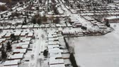 ипотека : Aerial view of the city. Hundreds of houses bird eye top view suburb urban housing development. Quite neighbourhood covered in snow, America. Winter season.