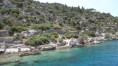 Ruins of sunken ancient city of Dolichiste on the northern part of the Kekova Island. Devastating earthquake in the 2nd century AD Stock Footage