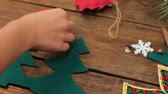 önemsiz şey : Preparation for the holiday. Making homemade New Year eco-friendly decoration on the Christmas tree. Unrecognizable woman sews diy xmas toys
