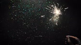congratulação : Firework sparkler on glittering background, close up free space loop footage. New Years magic night, holiday and celebration concept