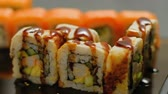 delicadeza : oriental cuisine. diet food japanese meal delicacy. sesame seeds sprinkle fall on sushi rolls