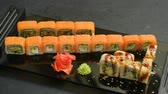 rodar : asian cuisine and japanese food. sushi rolls set assortment on dark background Stock Footage