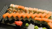 rodar : japanese cuisine restaurant menu. sushi rolls set assortment on dark background Stock Footage