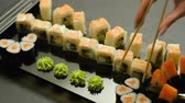 delicadeza : oriental cuisine restaurant meal order. sushi rolls set assortment. hand pick up roll