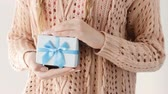Валентин : girl holding a present in a blue gift box. surprise for a male. congratulation celebration reward and gratitude concept. Стоковые видеозаписи