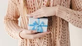 получать : present giving. girl getting a blue gift box from a man. anniversary or birthday congratulation. gratitude and reward concept.