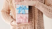 gratitude : gender presents. baby shower gift boxes. girl getting two packages of blue and pink color. celebration and surprise. special holiday congratulation.
