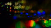 утечка : Defocused colorful lens flare. Bokeh multicolor glow. Blur night city billboard lights in motion.