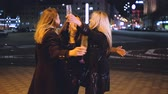 Girls night party. Female best friends having fun out. Drunk ladies enjoying time together, hugging on the street.