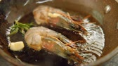 equilibrado : Seafood meal cooking. Mediterranian food recipe. Shrimps frying in pan
