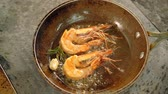 alecrim : Restaurant seafood meal preparation. Shrimps frying in pan with garlic and rosemary