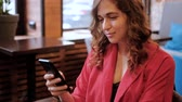 mancha : Communication and social networks. Woman texting or chatting on mobile phone in cafe. Stock Footage
