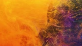 Liquid fire. Traveling light motion. Orange and purple inks flowing.