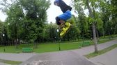 inline : Kids extreme leisure. Roller skate jumping over the ramp in a park