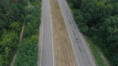 vozovka : Highway in rural countryside. Aerial view on two way road and cars driving Dostupné videozáznamy