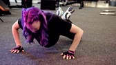 out of focus : Push ups exercise. Female fitness. Strong athletic woman working out