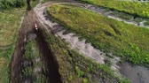 terreno extremo : Motocross hobby. Race drivers circling natural dirty track in cross country. Aerial shot
