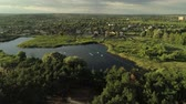 elite : Suburbs residential area. Flying over elite neighbourhood. Lake and forest landscape aerial view Stock Footage