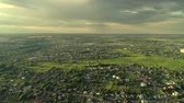 annegamento : Countryside scenery. Suburbs flyover. Aerial view on small town drowning in lush greenery