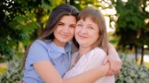 compreensão : Happy family relationship. Understanding support care. Cheerful mother daughter hugging smiling.