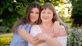 riunione : Mother daughter affection. Tender care love. Women embracing smiling enjoying time. Filmati Stock