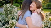 riunione : Mother daughter affection. Love care attention. Happy women hugging smiling.