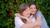 riunione : Happy family relationship. Bonding care affection. Cheerful mother daughter cuddling smiling.