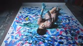 Creative leisure. Positive power of art. Happy woman dirty with paint enjoying hand dance on floor.