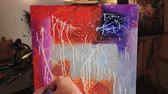 溶岩 : Color therapy. Emotions expression. Male hand splattering paint on canvas creating abstract picture.