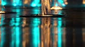waterworks : reflections of colorful fountain at night close-up
