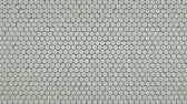 domborít : Wall of small white hexagons. Computer generated abstract motion background. Seamless loop 3D render animation 4k UHD (3840x2160)