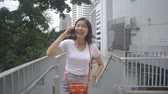 Happy Young Thai Woman talks on phone and laughs. Slow motion Stockvideo