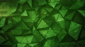 Layered green glossy low poly mesh. Abstract 3D render of futuristic sci-fi construction. Seamless loop smooth animation rendered with DOF 4k UHD (3840x2160)