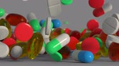 Medicine pills and capsules are falling on a surface. 3D render animation with depth of field