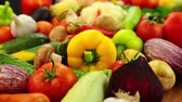 diet : Camera is flying slowly and low over a bunch of different vegetables with water drops after bathing
